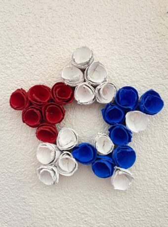 Patriotic Egg carton star wreath made with red white and blue cups for the 4th of July DIY Decor.